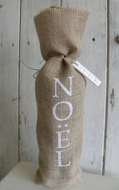 Burlap Christmas wine bottle bag with clay tag by TheNestUK