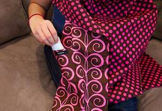Nursing cover with hidden pocket