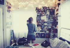 posters & fairy light on ceiling.
