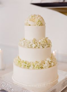 all white from cake to peony and hydrangea toppers