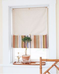 {someday} could DIY Roman shades with blackout lining sandwiched between coordinating fabrics