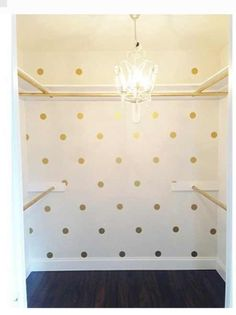 Gold polka dot closet. Looks like a kate spade boutique. What a way to get dressed every morning.