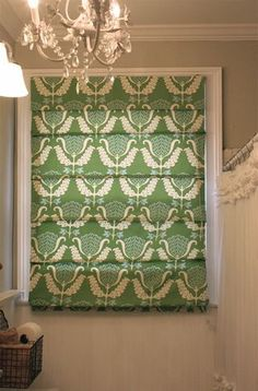 Easy DIY roman shade - use spray adhesive to attach fabric to a store-bought shade.