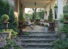 Wide, stone steps for this long porch.