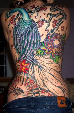 peacock tattoo with chinese influences