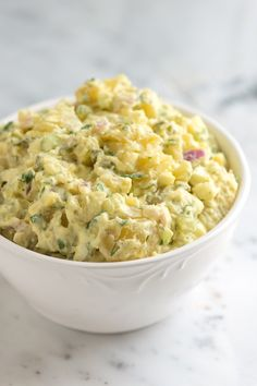 Potato Salad   2 pounds small yellow, red or white potatoes 1 tablespoon apple cider vinegar 1/2 cup sour cream 1/4 cup mayonnaise 1 tablespoon mustard 1/2 cup  finely chopped red onion (1 medium) 1/2 cup finely chopped celery (3 ribs) 1/3 cup finely chopped dill pickles 2 hard-boiled eggs, peeled and chopped 1/4 cup chopped fresh herbs Salt and freshly ground black pepper, to taste