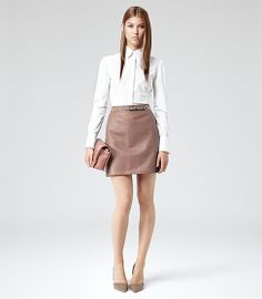 Team a classic white shirt with your leather mini and add a clutch to take your look into the evening #Reiss #SS14