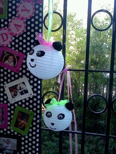 Panda chinese lanterns - Large black pom poms for ears;  felt used for eyes, nose and mouth.  Googlie eyes glued to eye shapes. Tie a ribbon to hand then use tulle to make a bow between the ears.
