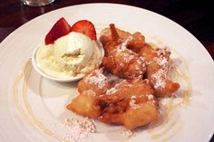 Loukoumades, a traditional Greek 'donut' tossed in cinnamon sugar and drizzled with a honey glaze and served with vanilla bean icecream @ Ridgeview Restaurant