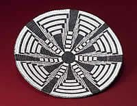 A beautiful new basket created by Loretta Saraficio done in the traditional Tohono O'odham style with a modern flair.