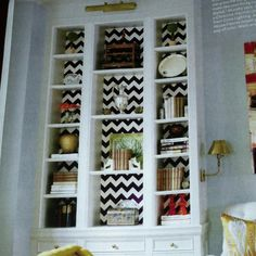 Great idea- #chevron wallpaper in #bookcase
