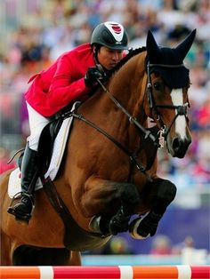Taizo Sugitani of Japan riding Avenzio competes in the 3rd Qualifier of Individual Jumping on Day 10 of the London 2012 Olympic Games at Greenwich Park.)