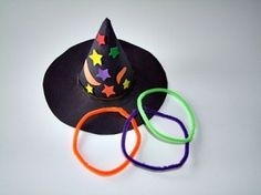 Ring toss on a witch's hat! Rings made of pipe cleaners. Clever!