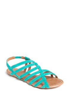 love the bright colors and asymmetrical curve on these sandals, come quickly Spring!