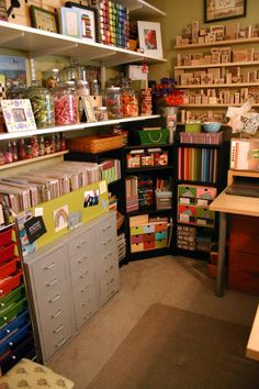 Small space craft room storage. Things I love: box surround for paper sorters, mini shelf under large shelves, frames on shelves, paint storage, corner storage, stamps on wall craft space, colorful crafts, small craft room storage, space novolin, craftroom, small spaces, new crafts, space crafts, craft rooms