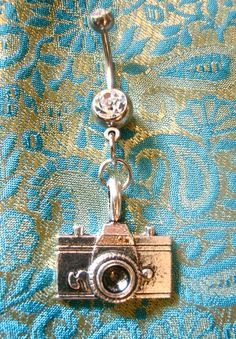 Camera belly button ring.