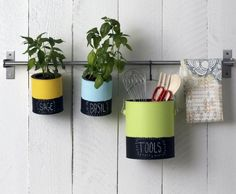 paint cans for herbs and tools.
