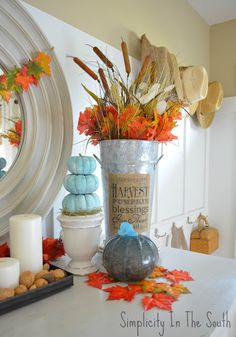 Thanksgiving display and a free fall printable banner. Blown glass pumpkin. Galvanized flower bucket with printed burlap.