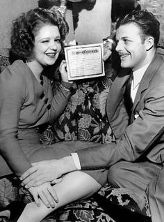 Actress Clara Bow shows off her marriage certificate with her husband Rex Bell.