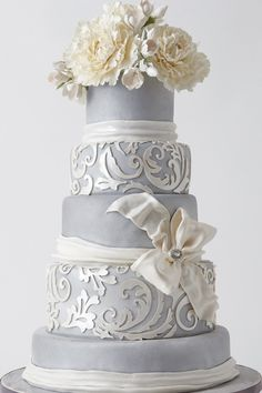 "Silver Jacquard"" cake with hand-cut overlay on silver-leaf fondant by Jay Muse of Lulu Custom Cake Boutique, via Bridal Guide"