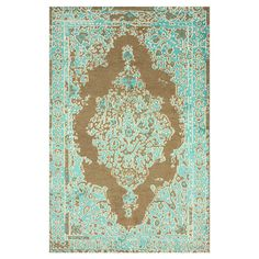 hand-knotted wool and art silk rug, showcasing a Persian-inspired motif in turquoise...