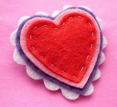 Felt heart brooch. I think my 4 year old would like to sew these. Leave out the pin, and it is a lovely gift for her preschool mates.