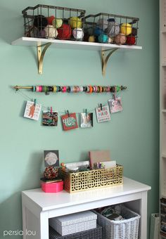 USe wire baskets for yarn and a small curtain rod for Washi tape storage. Great ideas! Check out the rest of this craft room.