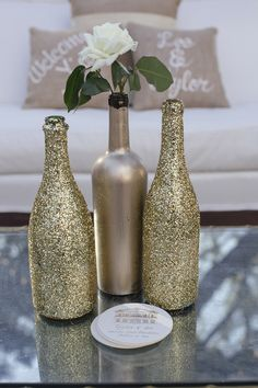 DIY Vases: Glittered + Painted Bottles | On SMP: http://www.stylemepretty.com/2013/11/15/charleston-wedding-from-paige-winn-photo | Photography: Paige Winn Photo