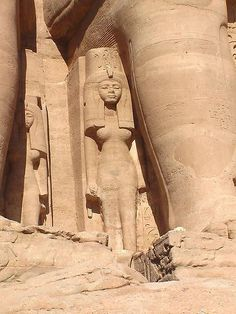 Nefertari means Beautiful Companion. Here she is portrayed standing next to the colossal statue of Ramssess II at Abu Simbel.