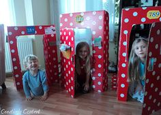 Cardboard houses complete with numbers, key-holes, letter boxes, flower boxes and a doorbell.