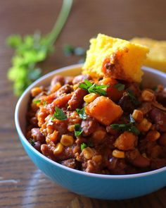 This recipe for Slow Cooker Sweet Potato Chili is perfect for cooler falls days. Top with sour cream and serve with warm corn bread. #CrockPot #SlowCooker #chili #recipe #fall