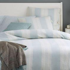 We used yarn-dyed threads on the Coastal Stripe Duvet Cover + Shams to achieve its subtle coloring. Tie closures add a homey feel.