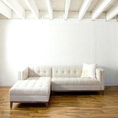 White sofa....  I love.  I wonder how much Scotch Guard is needed to keep that thing right and tight....