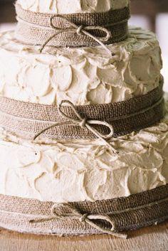 Burlap wrapped wedding cake..or use the same lace as mason jars
