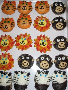 """I made these for my son's 3rd birthday party (jungle theme). I use 2 shades of orange frosting for the tiger. Lions were made with a candy peach ring & a smaller piece cut out to fill in the center, his ears are cheerios & his mane is made of Dots candies cut into pieces & """"glued"""" on with orange frosting. The zebra's nose is made by making a slit in the front of cupcake and pushing a round nutter butter (Target brand) in the slit, then frosting with black frosting. Milano cookies will also work."""