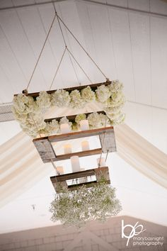 Sanderling Pavilion ceiling with these unique chandeliers by Bells  Whistles. Captured by Mary Basnight Photography  #OBX #OuterBanks #OBWA #Wedding