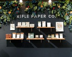 rifl paper, paper garlands, floating shelves, black walls, backdrops, jewelry displays, trade show booths, card displays, product display