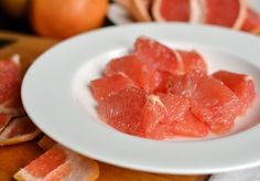 Cutting a grapefruit in segments.
