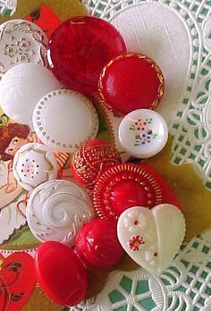 Sweet vintage, glass, red and white buttons.
