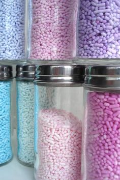 Custom Colored Sprinkles: white sprinkles (jimmies) or non-pareils;  powdered food coloring or petal dust; small plastic bags, toothpicks.  Put sprinkles in a ziploc bag.  Using toothpick, add a tiny bit of powdered food coloring, shake gently.  Add  more coloring as desired.  * glass jars for storage