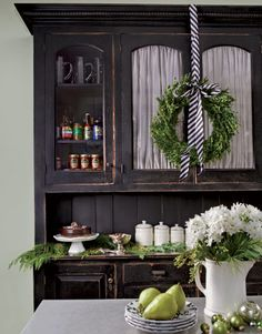 "Okay, technically, this could go in Holidays. And also, I'm starting to realize i need a ""Furniture pieces"" board. Anywho, I love both the wreath hung with black and white striped ribbon AND the gorg black curio!"