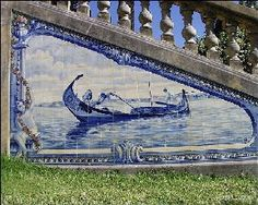 Portuguese tile depicting fishing boat and cherub.