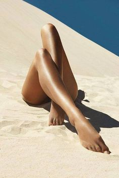 Pedicured feet in the sand