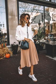 Fall pleated skirt sneakers style