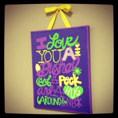 Purple scrapbook paper with lime green and yellow writing. I Love you a bushel and a peck and a hug around the neck.