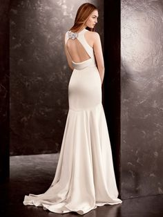 This double-faced satin gown is the epitome of old world elegance and class. White by Vera Wang Style VW351186 #davidsbridal #whitebyverawang #weddings #HelzbergDiamonds #AisleStyle #Entry