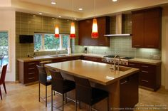 #Kitchen of the Day: Luxury Modern Kitchen with Dark Cherry Cabinets, Fiery Pendant Lights, and a Glass Tile Backsplash  (DesignerKitchensLA.com, Kitchen-Design-Ideas.org)