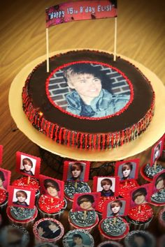 A Bieber cake and an army of Bieber cupcakes.