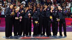 The United States women's Basketball team poses during the medal ceremony on Day 15 of the London 2012 Olympic Games at North Greenwich Arena.