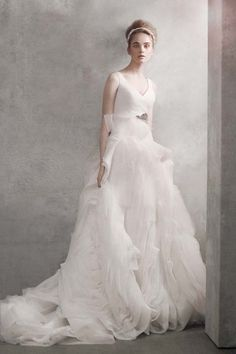 LOVE -- wedding gowns under $1000: vera wang white v-neck ballgown